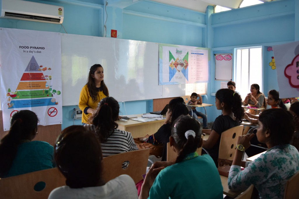 Training on Nutrition being provided to young women under one of the CSR-Sponsored projects of the DA Group